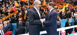 epa04540867 A handout picture provided by the Turkish Prime Minister Press Office shows Hamas leader Khaled Mechaal (L) and Turkish Prime Minister Ahmet Davutoglu (R) shakeing hands during a congress of Turkey's ruling Justice and Development Party (AKP) in Konya, Turkey, 27 December 2014. Davutoglu and Hamas leader attended a AKP party congress in Konya city. EPA/TURKISH PRIME MINISTER PRESS OFFICE / HANDOUT HANDOUT EDITORIAL USE ONLY/NO SALES