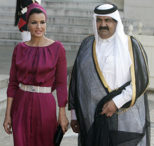 FILE - In this Monday, June 22, 2009 file photo, Emir Of Qatar Sheik Hamad Bin Khalifa Al Thani, right, and his wife Sheika Moza Bint Nasser Al Misnad arrive for the state dinner at the Elysee Palace in Paris. (AP Photo/ Francois Mori, File)