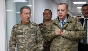 epa06474038 A handout photo made available by the Turkish Presidential Press Office shows Turkish President Recep Tayyip Erdogan (R) and Turkish Chief of Staff General Hulusi Akar (L) at the a military command center which is commanded of Olive Branch in Hatay, Turkey, 25 January 2018. Reports state that the Turkish army is on an operation 'named 'Operation Olive Branch' in Syria's northern regions against the Kurdish Popular Protection Units (YPG) forces which control the city of Afrin. Turkey classifies the YPG as a terrorist organization. EPA/TURKISH PRESIDENTAL PRESS OFFICE HANDOUT HANDOUT EDITORIAL USE ONLY/NO SALES