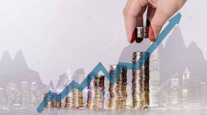 Double exposure of hand put money coins to stack of coins and financial chart graph background, Money, Financial, Business Growth and saving money concept, shallow focus.