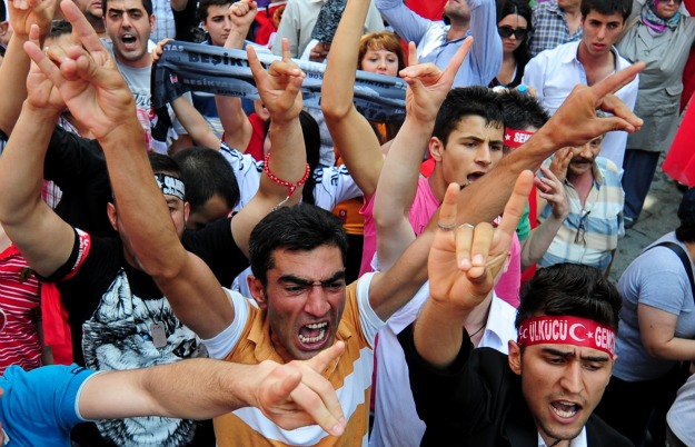 Turkish people chant slogans during a demonstration in Istanbul, on July 17, 2011, to denounce recent violence sparked by Kurdish separatist rebels which resulted in the killing of thirteen Turkish soldiers. More than 5,000 people rallied in the city to protest the fighting which broke out near the town of Silvan, in Diyarbakir province. AFP PHOTO / MUSTAFA OZER (Photo credit should read MUSTAFA OZER/AFP/Getty Images)